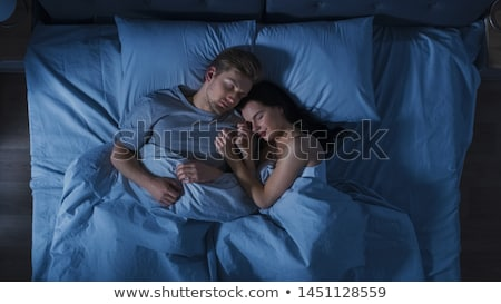Handsome couple in a dark room Stock photo © konradbak