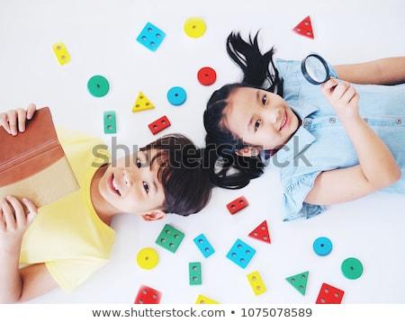 twee · kinderen · liggen · vloer · gezicht · haren - stockfoto © paha_l