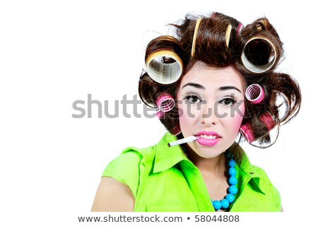 Woman with hair curlers smoking a cigarette Stock photo © photography33