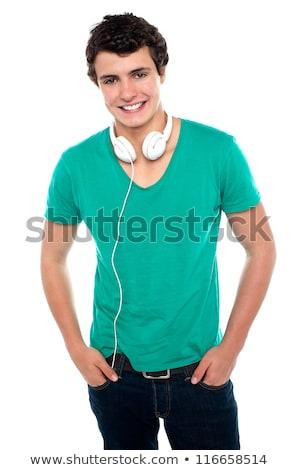 Teenagers posing with headphones around neck stock photo © stockyimages