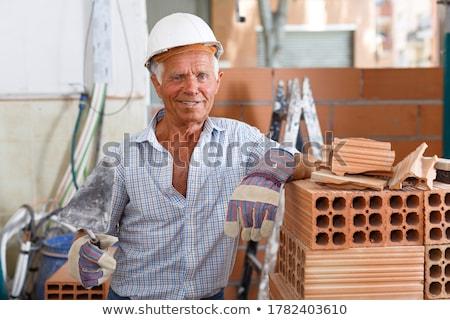 Rzemieślnik mason stwarzające budynku człowiek budowy Zdjęcia stock © photography33