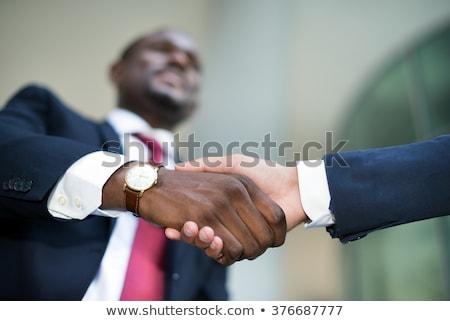 Interracial business hand-shake Stock photo © photography33