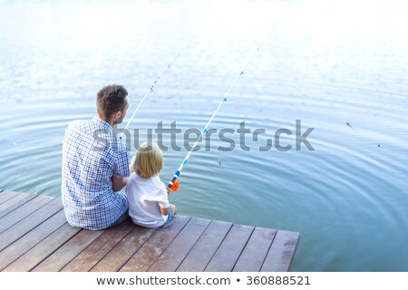 father teaching son how to fish stock photo © photography33