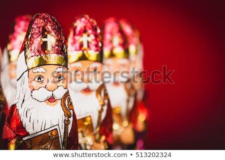 Papai noel estatueta dourado natal decorações Foto stock © photosebia