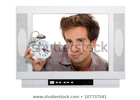 Man holding alarm clock trapped in the television Stock photo © photography33