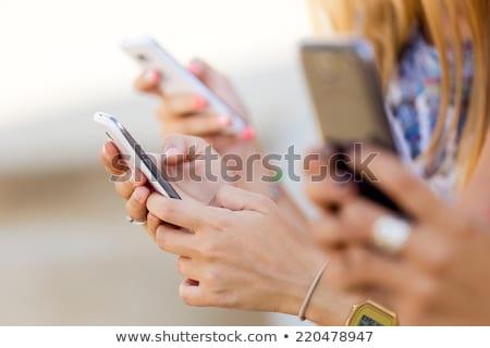 Trzy kobiet komórkowych strony telefonu szczęśliwy Zdjęcia stock © photography33