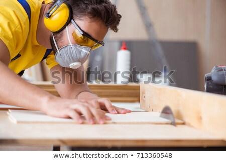 a handyman holding a circular saw stock photo © photography33