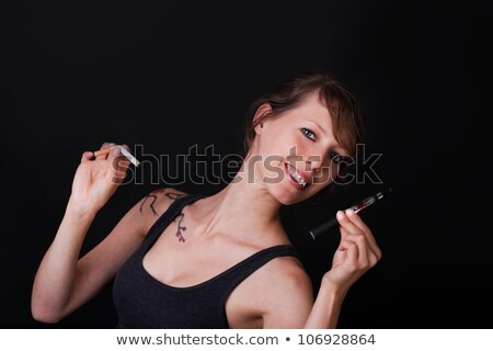Young handsome woman decides for elektronic cigarette Stock photo © Pasiphae