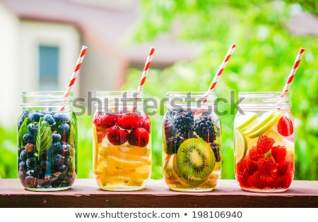 fresh cold drink water ice cubes peppermint lime raspberry stock photo © juniart