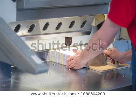Man working on the guillotine for paper Stock photo © simpson33