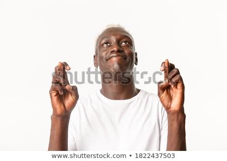 надеющийся молодым человеком глядя впереди вызывать жест Сток-фото © georgemuresan