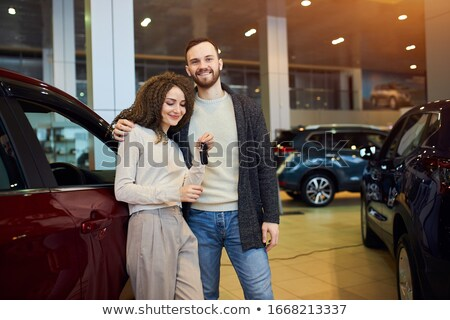 Guy with arms around her girlfriend's waist Stock photo © stockyimages