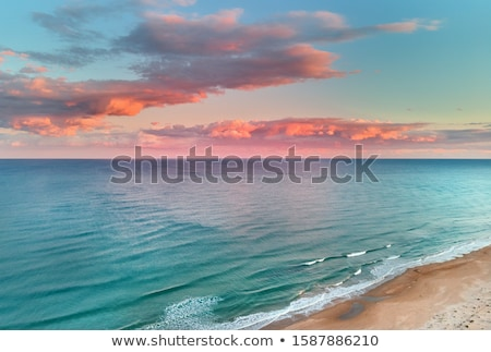 Naplemente napfelkelte mediterrán tenger kék víz Stock fotó © lunamarina