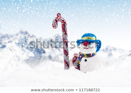 stripy candy cane and xmas hat Stock photo © jirkaejc