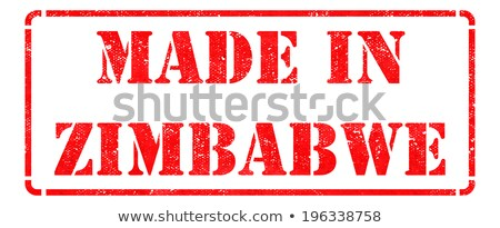 Made in Zimbabwe - inscription on Red Rubber Stamp. Stock photo © tashatuvango