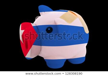 bankrupt piggy rich bank in colors of national flag of cuba    c Stock photo © vepar5