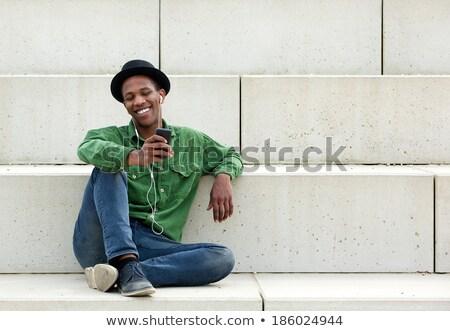 Vent luisteren mp3-speler knap jonge favoriet Stockfoto © toocan