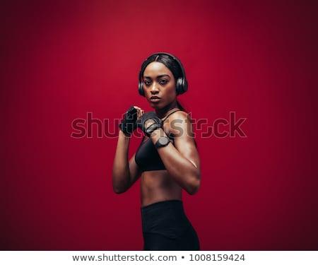 Vastbesloten vrouw Rood bokshandschoenen aantrekkelijk Stockfoto © dash