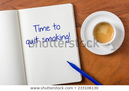 Notebook on a desk - Time to quit smoking Stock photo © Zerbor