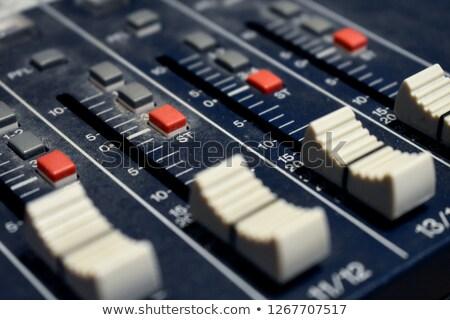 Csendes fekete irányítás konzol kék háttérvilágítás Stock fotó © tashatuvango