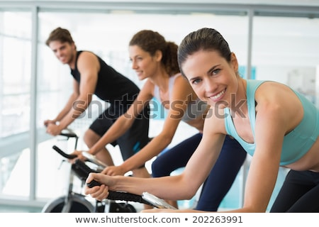 Pretty fit woman on the spin bike smiling at camera Stock photo © wavebreak_media
