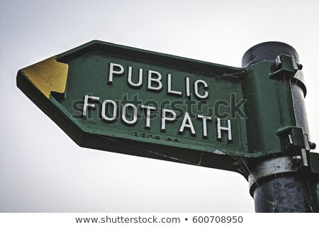 Public footpath sign points left and right Stock photo © sarahdoow