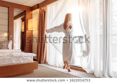 Bathrobe woman sunny window white curtains Stock photo © lunamarina