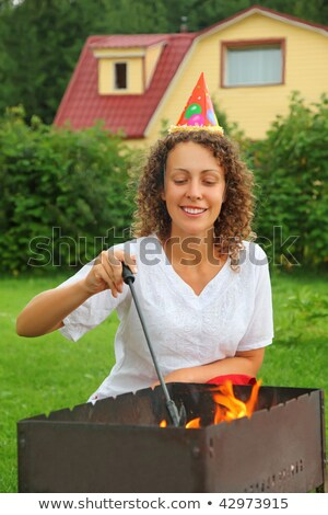 young woman near in cap brazier on picnic, happy birthday Stock photo © Paha_L
