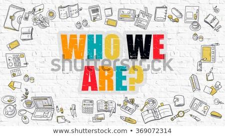 Multicolor Who We Are on White Brickwall. Doodle Style. Stock photo © tashatuvango