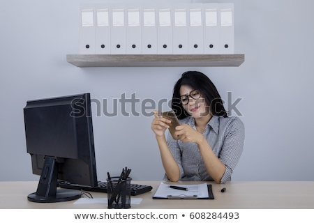 Stock photo: Indian Businesswoman using phone near office