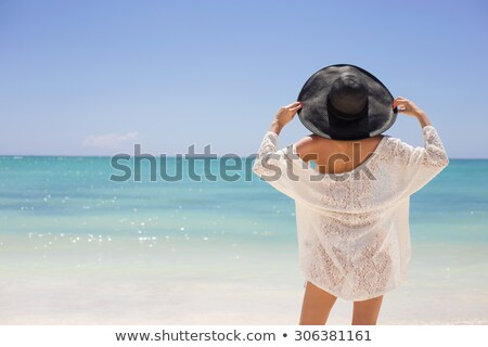 strand · vrouw · ontspannen · bikini · Geel - stockfoto © Maridav