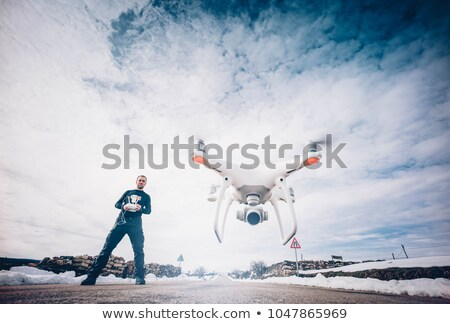 white drone flying above mountains stock photo © manaemedia