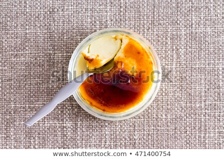 Partially eaten browned creme brulee with spoon Stock photo © ozgur