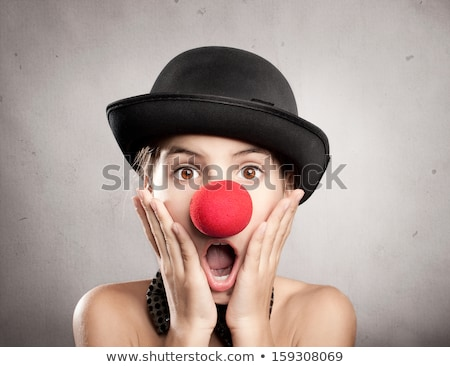 portrait of little girl with a clown nose stock photo © phbcz