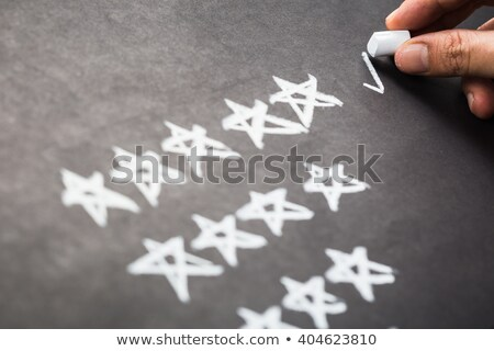 Writing review with white chalk on a blackboard. Stock photo © latent