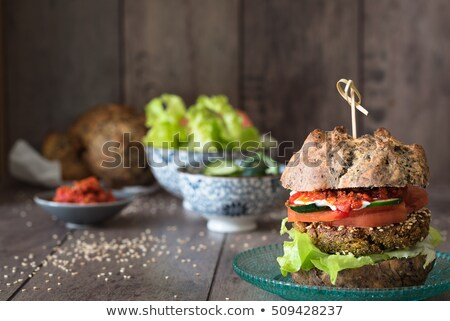 veggie burger, vegetables, sauces and small bowls with vegetables on background Stock photo © faustalavagna