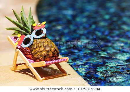 young pretty woman at swimming pool relaxing in chair fashion l stock photo © iordani