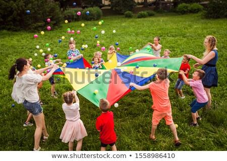 мальчика девушки площадка Blur трава девочек Сток-фото © deandrobot