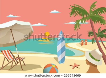 scene with umbrellas and surfboard on the beach stock photo © bluering