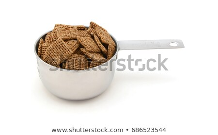 Malted shredded wheat biscuits breakfast cereal in a measuring c Stock photo © sarahdoow