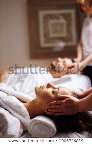 Couple receiving a head massage from masseur Stock photo © wavebreak_media