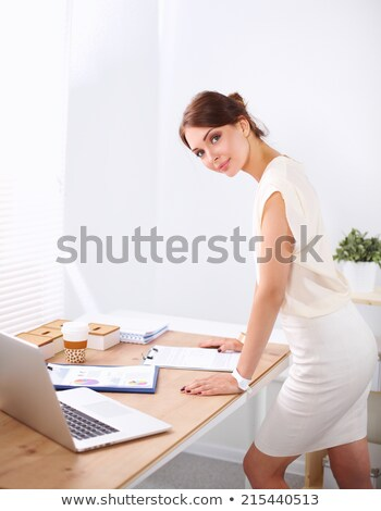 Young businesswoman standing at table Stock photo © IS2