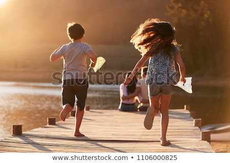 Family in countryside running with nets Stock photo © IS2