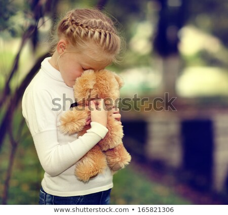 caucasian girl crying and holding toy stock photo © rastudio