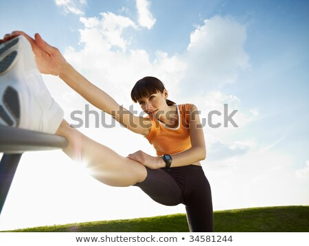 Low angle view of woman stretching Stock photo © IS2