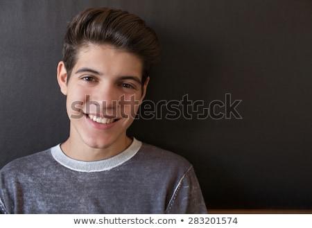 Portrait of teenage boy in bedroom Stock photo © IS2
