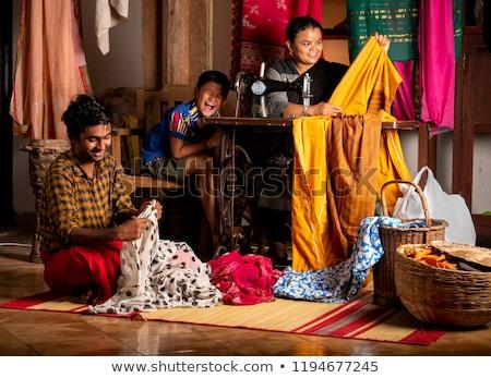 Woman stitching clothes Stock photo © Kzenon