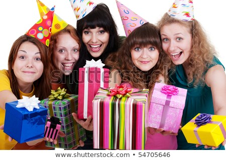 positive group of friends holding presents gifts boxes stock photo © deandrobot