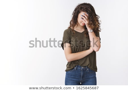 Embarrassed girl on white background Stock photo © bluering