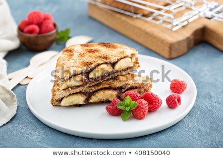 delicious open sandwich with chocolate and banana stock photo © melnyk